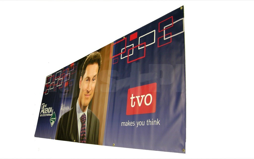 Shown is a 4 foot high x 12 foot wide scrim vinyl banner with reinforced hems all around and grommets every two feet