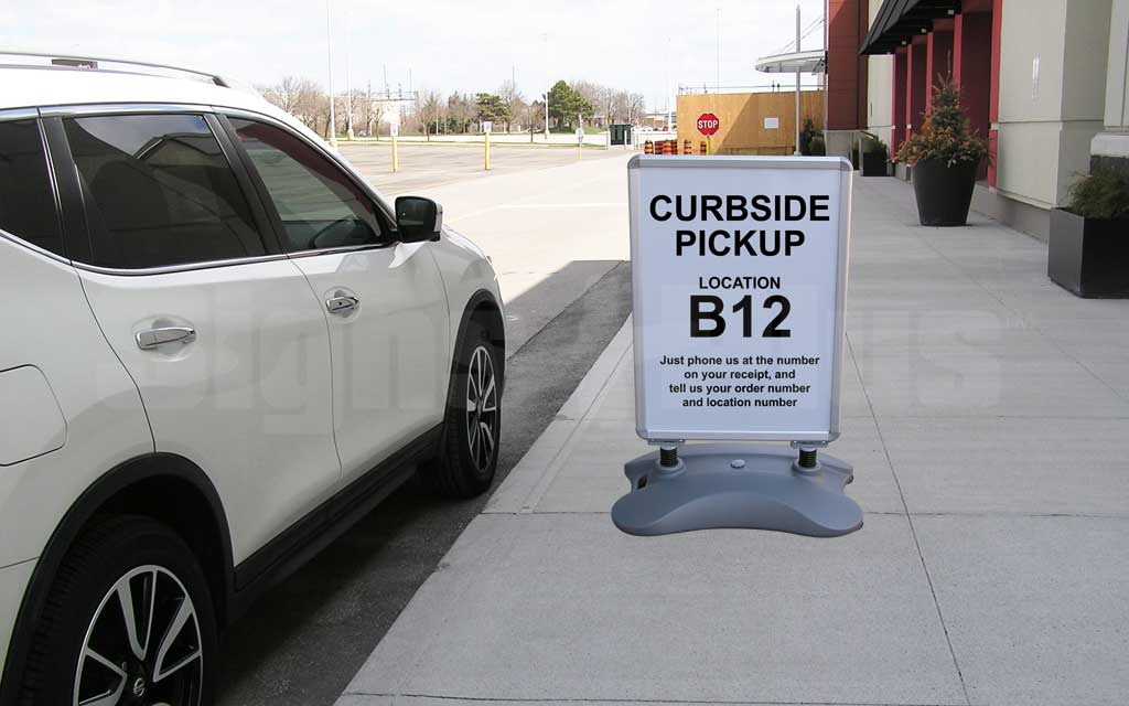 The Whirlwind outdoor portable wheeled sidewalk sign frame is ideal for directing curbside pickup traffic