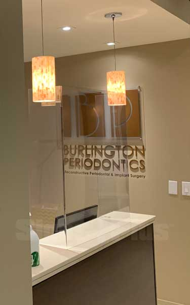 "Sneeze Guard clear partitions are light, simple and unobtrusive - great for medical office reception desks (32"" w x 32"" h 3mm polycarbonate shown - photo courtesy of Burlington Periodontics)"