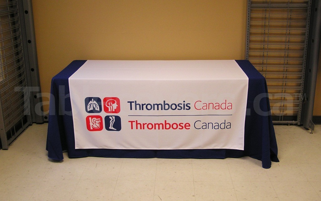 This 60 Inch X 60 Inch Table Runner With Logo On A White Background Stands  Out