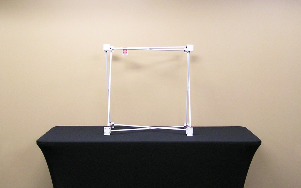 The Velocé Image 1x1 2.5 foot straight frame hardware includes a tubular metal scissor frame with velcro tabs on hubs and soft nylon carrying bag