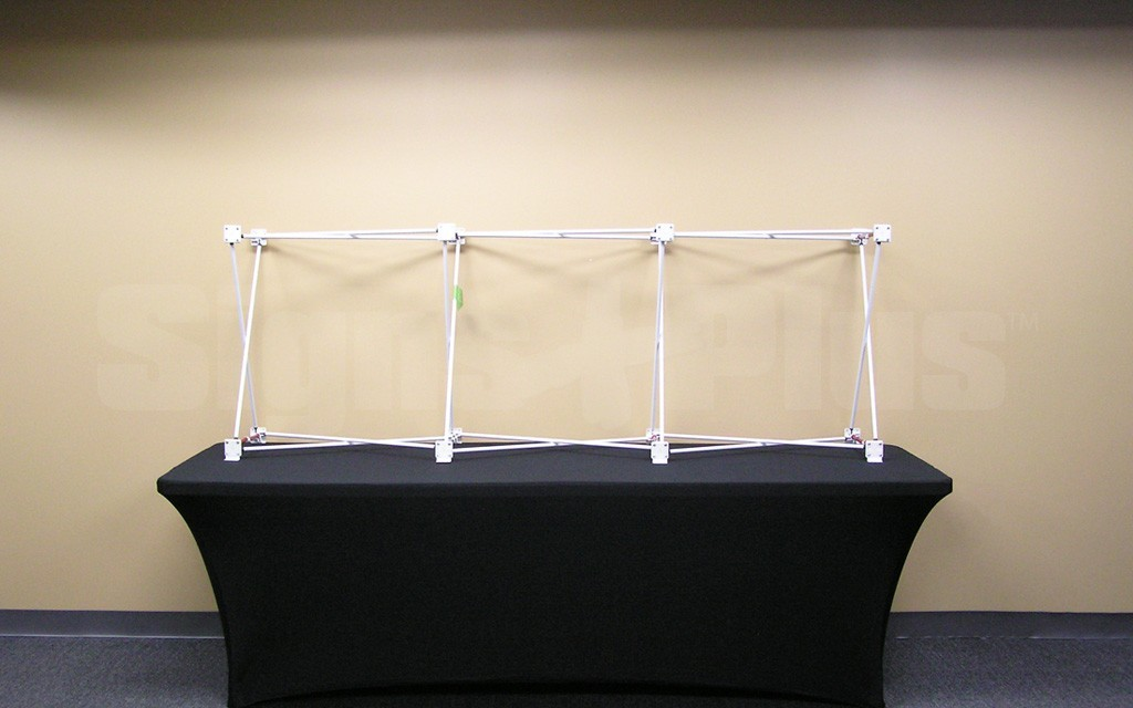 The Velocé Image 3x1 7 foot wide straight frame hardware includes a tubular metal scissor frame with velcro tabs on hubs and soft nylon carrying bag
